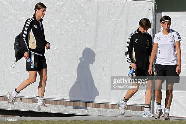 Kerstin Garefrekes assistant coach Bettina Wiegmann and Ariane Hingst of Germany walk to the Germany Women national team training session at training...