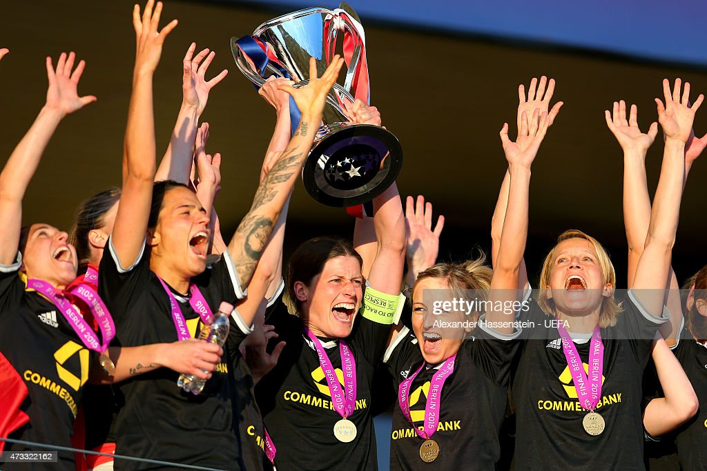 Kerstin Garefrekes of 1. FFC Frankfurt lifts the UEFA Women's Champions League winners trophy after the UEFA Women's Champions League final match between 1. FFC Frankfurt and Paris St. Germain at Friedrich-Ludwig-Jahn Sportpark on May 14, 2015 in Berlin, Germany.