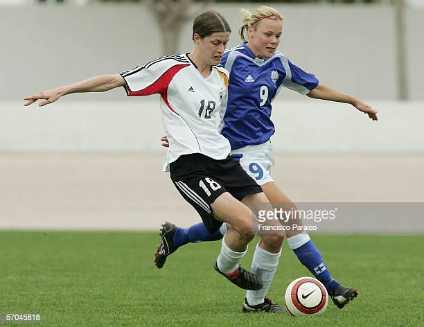 Kerstin Garefrekes of Germany and Laura Kalmari of Finland battle for the ball during the Womens Algarve Cup match between Germany and Finland on...