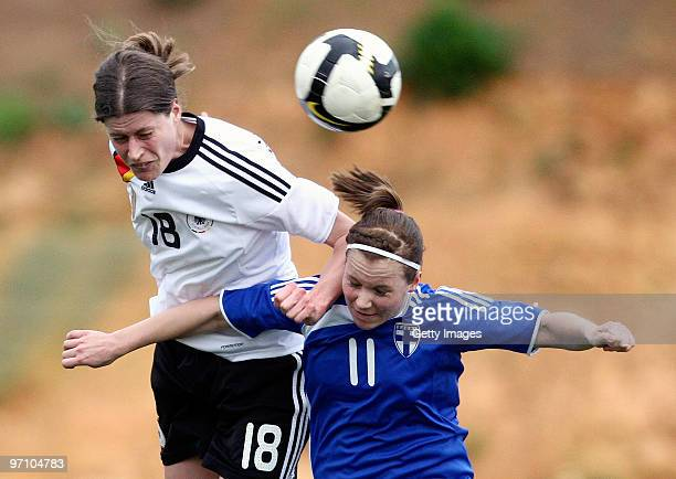 Kerstin Garefrekes of Germany and Susanna Lehtinen of Finland battle for the ball during the Woman's Algarve Cup match between Germany and Finland at...
