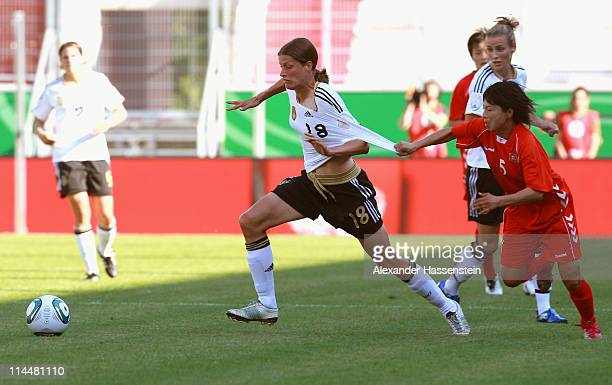 Kerstin Garefrekes of Germany battles for the ball with Jong Sun Song of DPR Korea during the International friendly match between Germany and DPR...