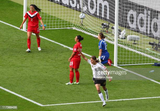 Kerstin Garefrekes of Germany celebrates after she scores her team's opening goal during the FIFA Women's World Cup 2011 Group A match between...