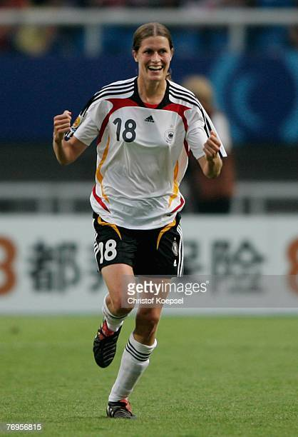 Kerstin Garefrekes of Germany celebrates her first goal during the Quarter Final Womens World Cup 2007 match between Germany and Korea at Wuhan...