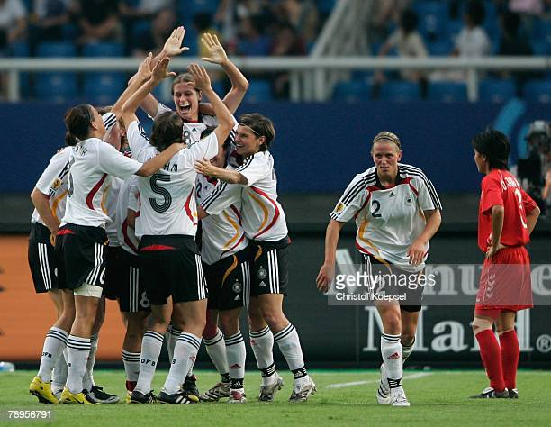 Kerstin Garefrekes of Germany celebrates her first goal with the team during the Quarter Final Womens World Cup 2007 match between Germany and Korea...
