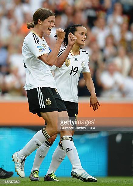Kerstin Garefrekes of Germany celebrates scoring the opening goal with Fatmire Bajramaj during the FIFA Women's World Cup 2011 Group A match between...