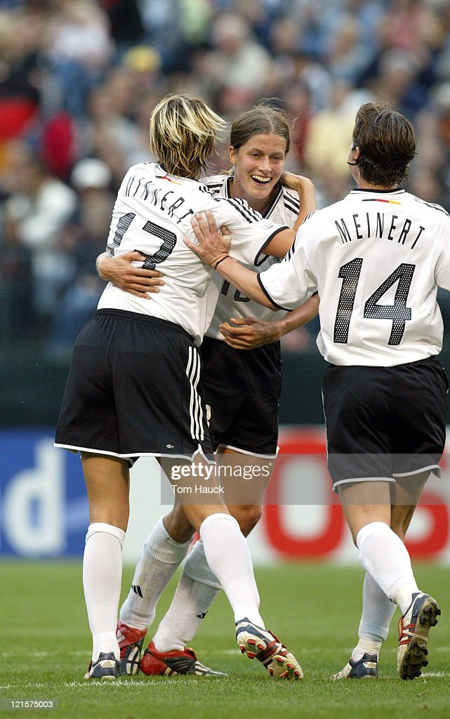 Kerstin Garefrekes #18 of Germany celebrates with teammates after scoring a goal on Russia October 2, 2003, at PGE Park in Portland, Oregon. Germany defeated Russia 7-1 in The 2003 Women's World Cup Quarterfinal match.