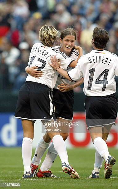 Kerstin Garefrekes of Germany celebrates with teammates after scoring a goal on Russia October 2 at PGE Park in Portland Oregon Germany defeated...