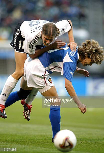 Kerstin Garefrekes of Germany collides with Marina Burakova of Russia during game action October 2 at PGE Park in Portland Oregon Germany defeated...