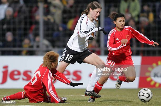 Kerstin Garefrekes of Germany competes with Yali Liu and Huana Liu of China during the women's international friendly match between Germany and China...