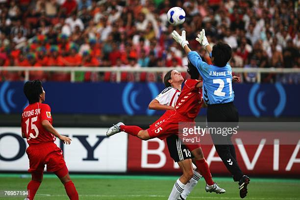 Kerstin Garefrekes of Germany Jon Myong Hui of North Korea go up for a header during the quarter final match of FIFA Women's World Cup China 2007 at...