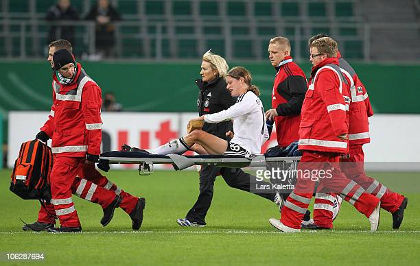 Kerstin Garefrekes of Germany leaves the pitch due to an injury during the women's international friendly match between Germany and Australia at...
