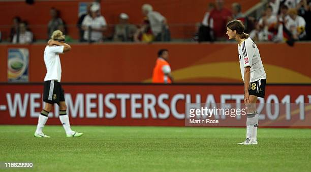 Kerstin Garefrekes of Germany looks dejected after the FIFA Women's World Cup 2011 Quarter Final match match between Germany and Japan at Wolfsburg...