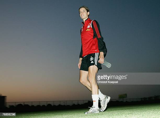 Kerstin Garefrekes walks off the pitch after the Women's German National Team training session on the training ground at the Wuhan Sports Center...