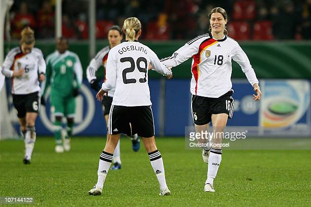 Kerstin Garrefrekes of Germany celebrates after scoring her team's second goal with team mate Lena Goessling of Germany during the women's...