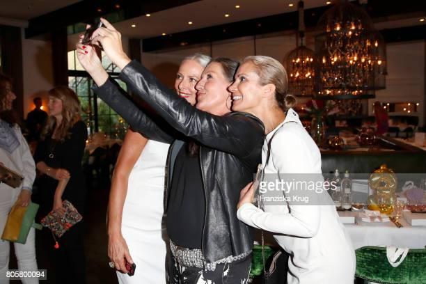Kerstin Linnartz Katy Karrenbauer and Petra van Bremen attend the Annabelle Mandeng Hosts Ladies Dinner In Berlin on July 2 2017 in Berlin Germany