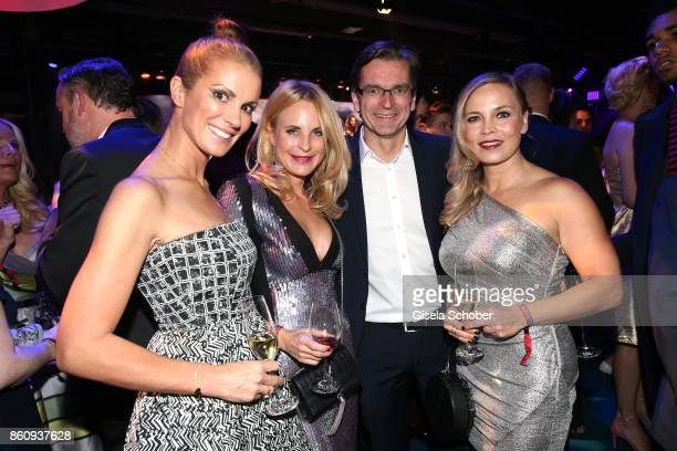 Kerstin Linnartz Sonja Kiefer Claus Strunz and Regina Halmich during the 'Tribute To Bambi' gala at Station on October 5 2017 in Berlin Germany