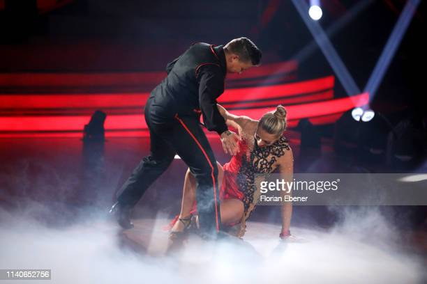Kerstin Ott and Regina Luca fall during the 3rd show of the 12th season of the television competition Let's Dance on April 05 2019 in Cologne Germany