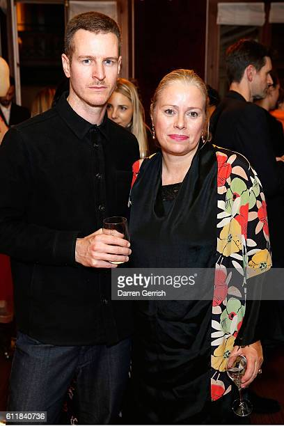 Kerstin Schneider and Nils Binnberg attend the MATCHESFASHIONCOM x Simone Rocha dinner at Restaurant Laperouse on October 1 2016 in Paris France