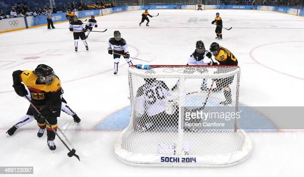 Kerstin Spielberger of Germany scores on a pass from Nina Kamenik against Mika Hori and Nana Fujimoto of Japan in the third period during the women's...
