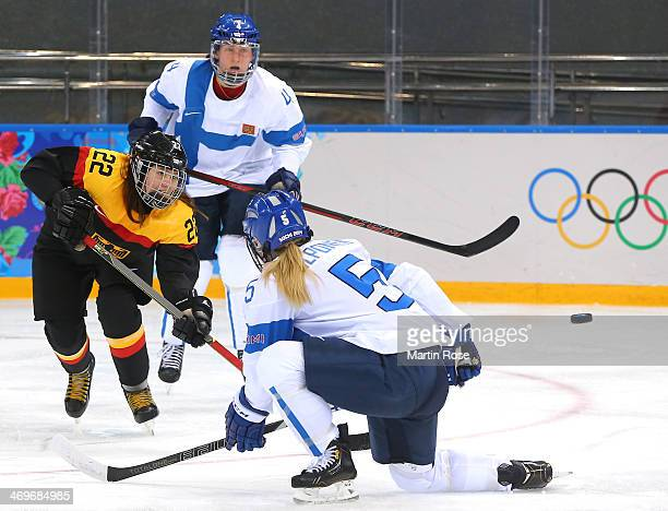 Kerstin Spielberger of Germany shoots against Anna Kilponen of Finland during the Women's Ice Hockey Classification game on day nine of the Sochi...