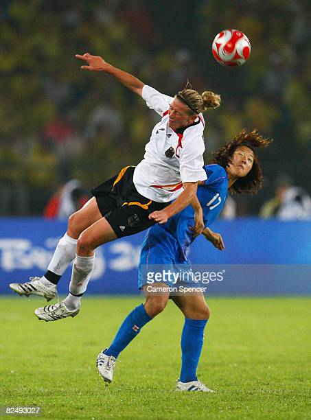 Kerstin Stegemann of Germany battles for a header with Yuki Nagasato of Japan during the Women's Football Bronze Medal match between Germany and...
