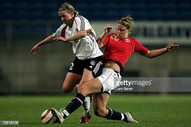 Kerstin Stegemann of Germany in action with Elise Thorsenes of Norway during the Algarve Cup match between Germany and Norway on March 7, 2007 in...