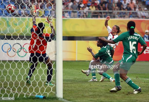 Kerstin Stegemann of Germany scores the winning goal during the Women's First Round Group F match between Nigeria and Germany in Shenyang Olympic...