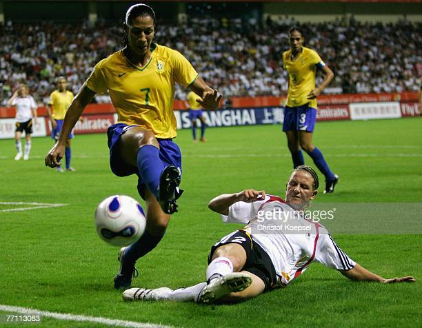 Kerstin Stegemann of Germany tackles Daniela of Brazil during the Women's World Cup 2007 Final match between Brazil and Germany at the Shanghai...