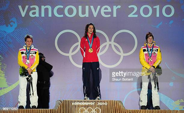 Kerstin Szymkowiak of Germany receives the silver medal Amy Williams of Great Britain and Northern Ireland receives the gold medal and Anja Huber of...