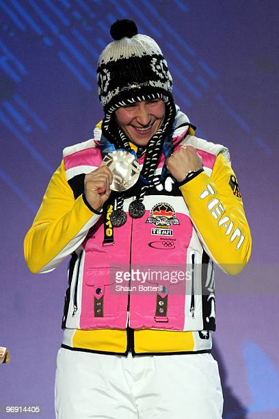 Kerstin Szymkowiak of Germany receives the silver medal during the medal ceremony for the women's skeleton held at the Whistler Medals Plaza on day 9...