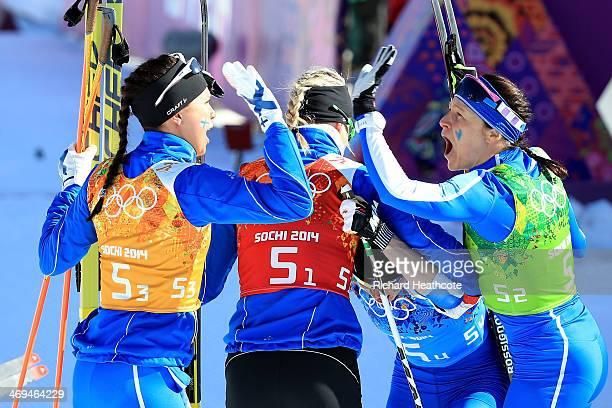 Kerttu Niskanen Anne Kylloenen Krista Lahteenmaki and AinoKaisa Saarinen of Finland celebrate winning the silver medal in the Women's 4 x 5 km Relay...