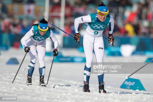 Kerttu Niskanen of Finland and Krista Parmakoski of Finland in action during the CrossCountry Skiing Ladies' 30km Mass Start Classic at the Alpensia...