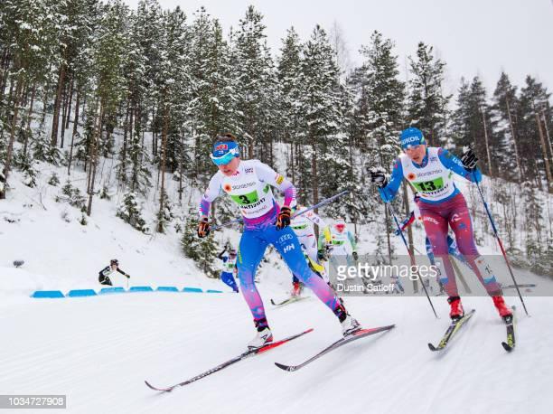 Kerttu Niskanen of Finland and Natalia Matveeva of Russia compete in the Women's Cross Country Team Sprint Final during the FIS Nordic World Ski...