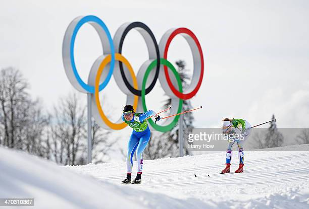 Kerttu Niskanen of Finland and Stina Nilsson of Sweden compete in the Women's Team Sprint Classic Semifinals during day 12 of the 2014 Sochi Winter...