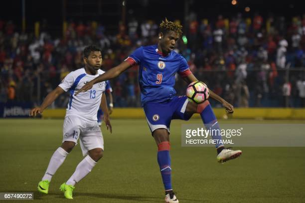 Kervens Belfort of Haiti vies for the ball with Brian Garcia of Nicaragua during the first of two match to define the last qualified to the 2017 Gold...