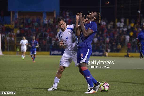 Kervens Belfort of Haiti vies for the ball with Daniel Cadena of Nicaragua during the first of two match to define the last qualified to the 2017...
