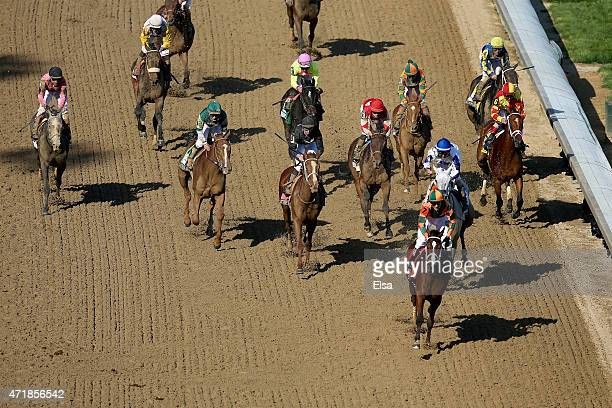 Kerwin D Clark leads the field across the finish line atop Lovley Maria after the 141st running of the Kentucky Oaks at Churchill Downs at Churchill...