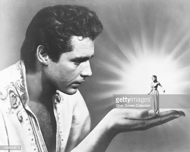 Kerwin Mathews US actor holding a shrunken Kathryn Crosby US actress and singer in the palm of his hand in an image issued as publicity for the film...