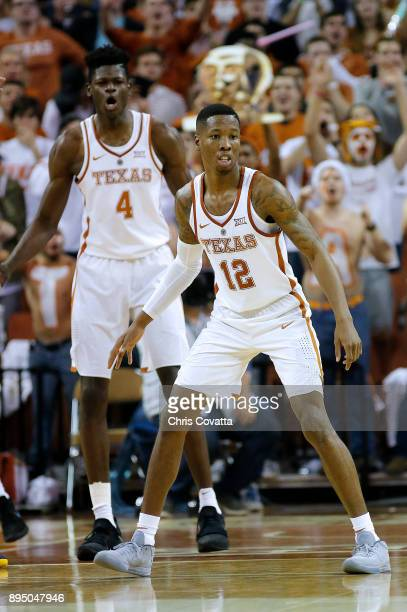 Kerwin Roach II and Mohamed Bamba of the Texas Longhorns play defense against the Michigan Wolverines at the Frank Erwin Center on December 12 2017...