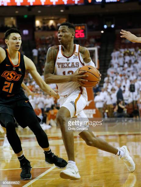 Kerwin Roach II of the Texas Longhorns drives around Lindy Waters III of the Oklahoma State Cowboys at the Frank Erwin Center on February 24 2018 in...
