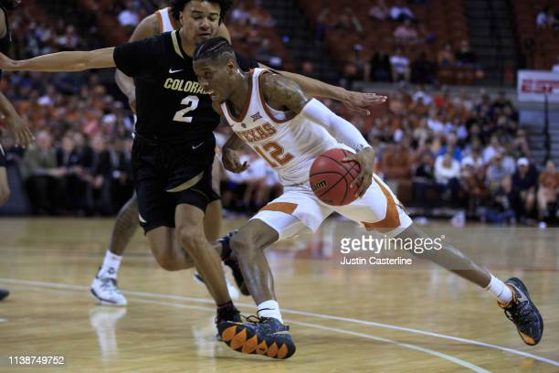 Kerwin Roach II of the Texas Longhorns drives to the basket in the game against the Colorado Buffaloes during the first half at The Frank Erwin...