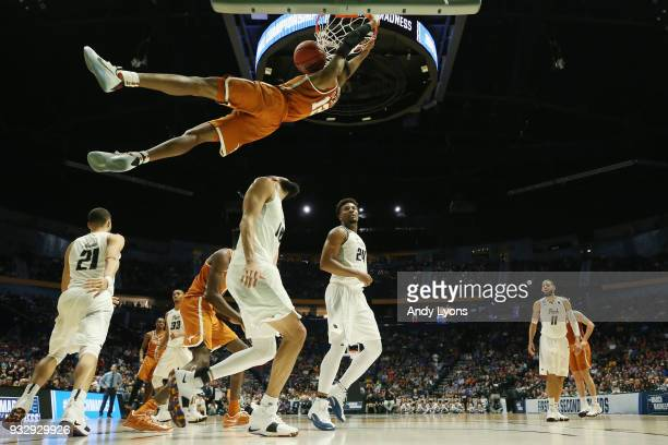 Kerwin Roach II of the Texas Longhorns dunks the ball against the Nevada Wolf Pack during the game in the first round of the 2018 NCAA Men's...