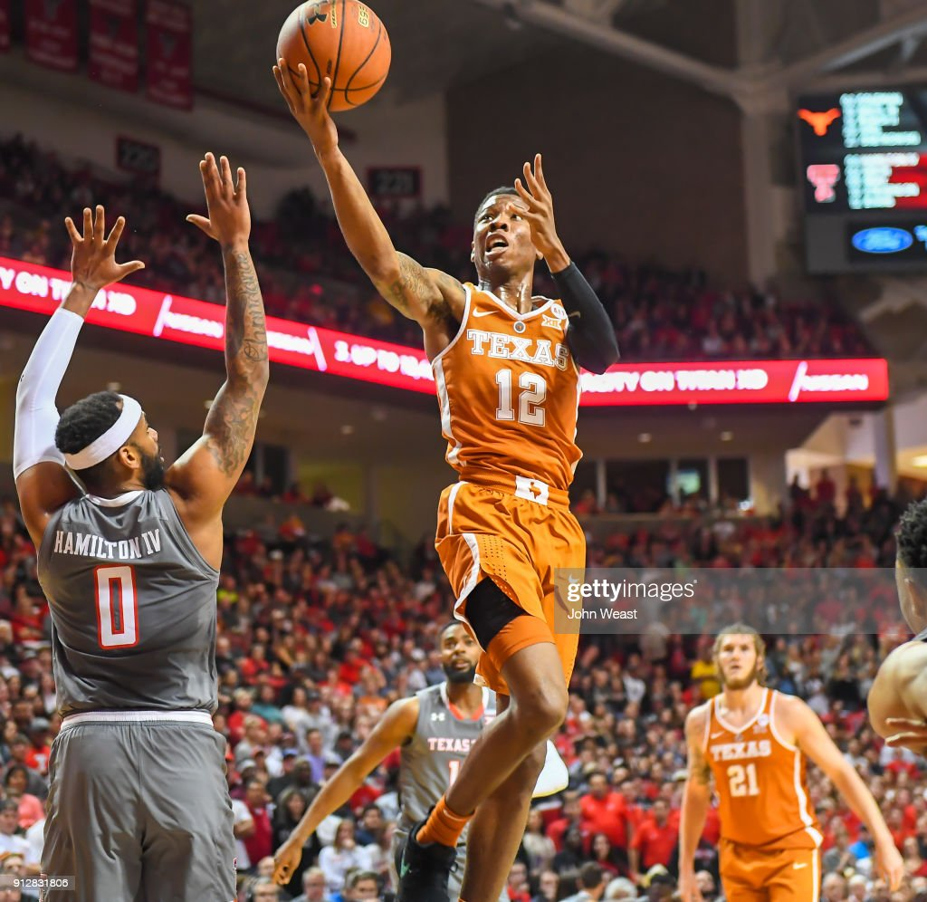 Kerwin Roach II #12 of the Texas Longhorns goes to the basket against Tommy Hamilton IV #0 of the Texas Tech Red Raiders during the first half of the game on January 31, 2018 at United Supermarket Arena in Lubbock, Texas.