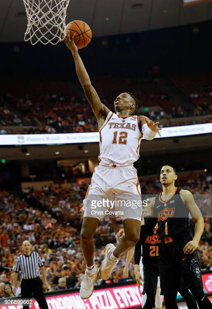 Kerwin Roach II of the Texas Longhorns goes up for a shot against Kendall Smith of the Oklahoma State Cowboys at the Frank Erwin Center on February...