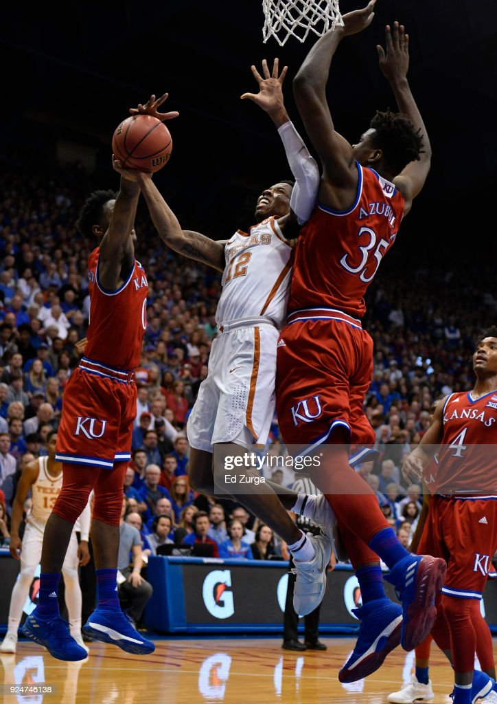 Kerwin Roach II #12 of the Texas Longhorns is fouled by Marcus Garrett #0 of the Kansas Jayhawks as he goes up for shot against Udoka Azubuike #35 of the Kansas Jayhawks in the second half at Allen Fieldhouse on February 26, 2018 in Lawrence, Kansas.