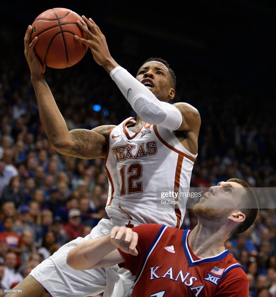 Kerwin Roach II #12 of the Texas Longhorns lays the ball up against Sviatoslav Mykhailiuk #10 of the Kansas Jayhawks in the second half at Allen Fieldhouse on February 26, 2018 in Lawrence, Kansas.