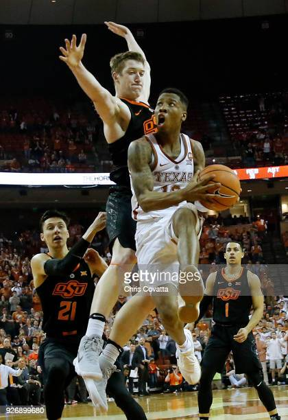 Kerwin Roach II of the Texas Longhorns leaps to the basket against Mitchell Solomon of the Oklahoma State Cowboys to make the winning score at the...