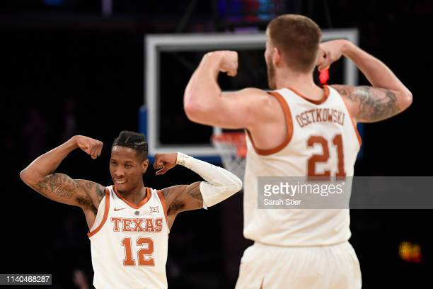 Kerwin Roach II of the Texas Longhorns reacts with teammate Dylan Osetkowski during the first half of the game against the Lipscomb Bisons at Madison...