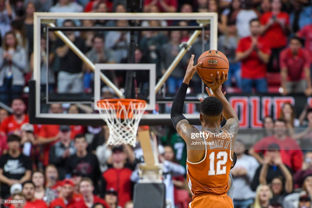 Kerwin Roach II #12 of the Texas Longhorns scores a three-pointer late in the game between the Texas Tech Red Raiders and the Texas Longhorns on January 31, 2018 at United Supermarket Arena in Lubbock, Texas. Texas Tech defeated Texas 73-71 in overtime.