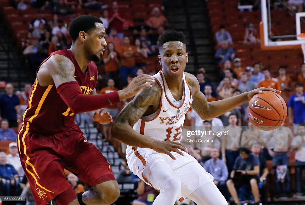 Kerwin Roach Jr. #12 of the Texas Longhorns drives around Monte Morris #11 of the Iowa State Cyclones at the Frank Erwin Center on February 7, 2017 in Austin, Texas.